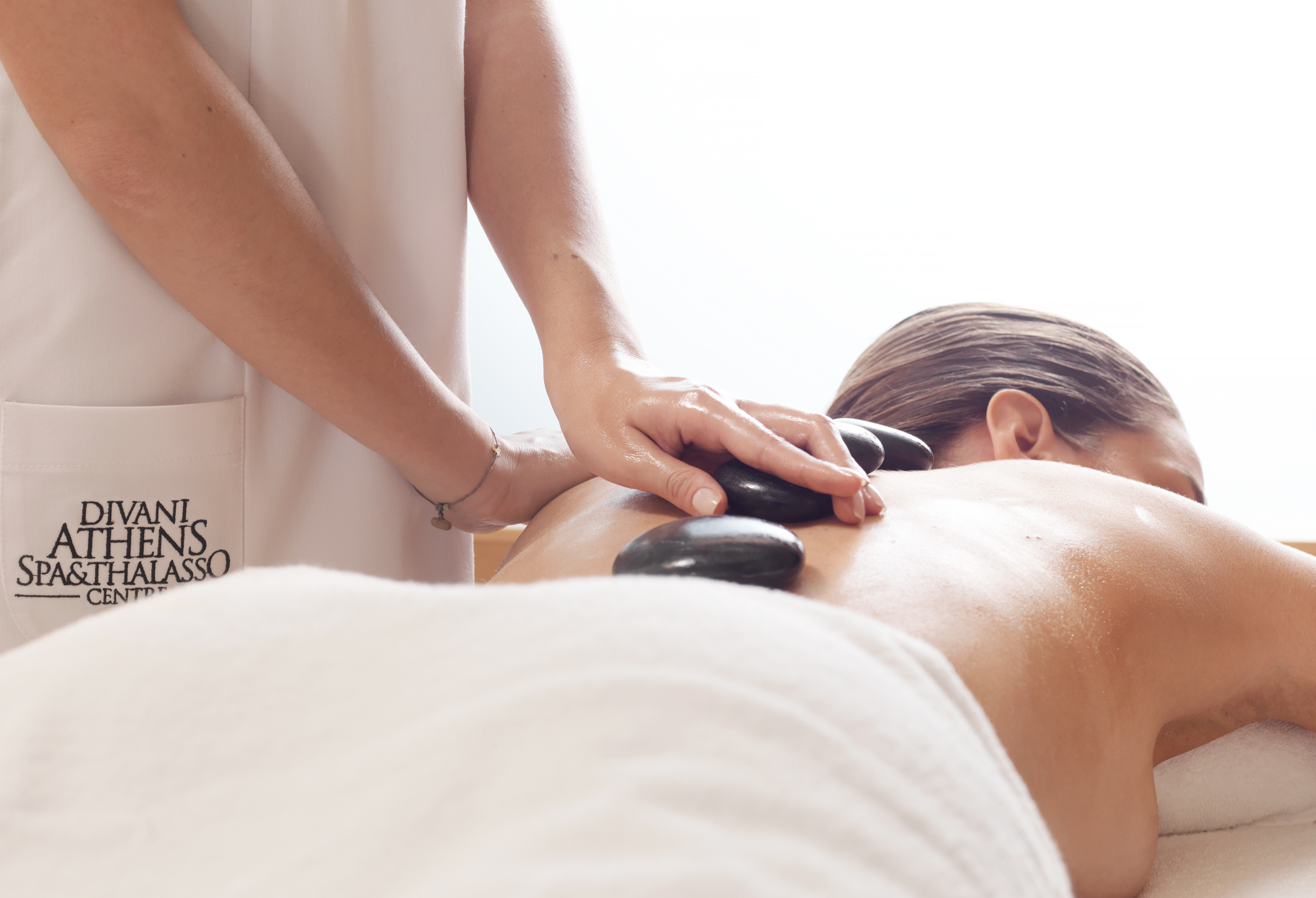Divine You Mag - Benefits of hot stone massage